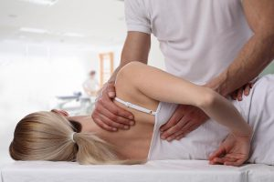 Chiropractor working on the back