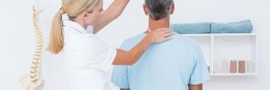 Chiropractor checking the neck area