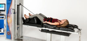 Lady on IDD Therapy Machine at Bolton Spinal Health