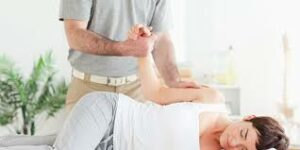 Lady receiving Chiropractic Treatment