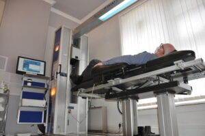 IDD Therapy at Bolton Spinal Health. The image shows a man on the IDD Therapy machine at Bolton Spinal Health.
