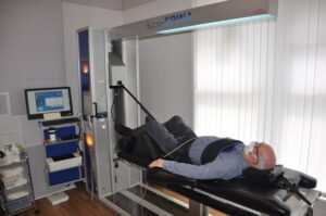 Man on the IDD Therapy Machine at Bolton Spinal Health